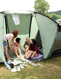 Four pretty teenage girls fondling bodies in a large tent