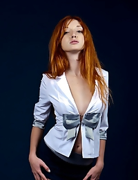 The sultry and confident redhead Michelle H fulfills your fantasy of a super hot corporate tease.