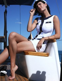 """The fun and playful Suzanna A portrays a naughty mariner, eager to show off her delicious body on board."""